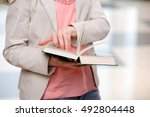 young student reading book in... | Shutterstock . vector #492804448