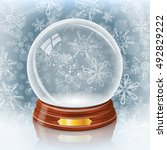 empty snowy glass ball against... | Shutterstock . vector #492829222