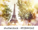 view on eiffel tower through... | Shutterstock . vector #492844162