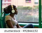 young black woman listening... | Shutterstock . vector #492866152