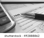 us tax form 1040 with pen and... | Shutterstock . vector #492888862