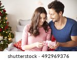 giving the christmas presents... | Shutterstock . vector #492969376