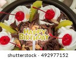 birthday cake on perforated... | Shutterstock . vector #492977152