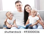happy parents with daughters... | Shutterstock . vector #493000036
