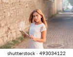beautiful young woman in white... | Shutterstock . vector #493034122