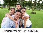 portrait of happy hugging... | Shutterstock . vector #493037332