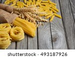 raw pasta and wheat on rustic... | Shutterstock . vector #493187926