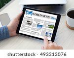 male hands holding tablet... | Shutterstock . vector #493212076