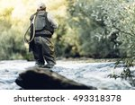 Fly fisherman using flyfishing...