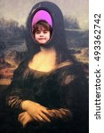 "Small photo of AUCKLAND - OCT 05 2016:Child (Talya Ben-Ari age 6) smile in a cut out face of The Mona Lisa painting by Leonardo da Vinci, acclaimed as ""the best known work of art in the world""."