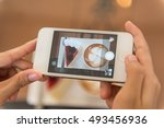 hands taking photo cake and... | Shutterstock . vector #493456936