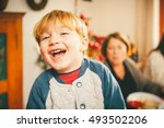 laughing child at christmas... | Shutterstock . vector #493502206