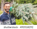 man holding christmas tree at... | Shutterstock . vector #493518292