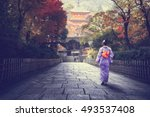 japanese woman walking to red... | Shutterstock . vector #493537408