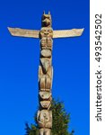 Small photo of VANCOUVER, CANADA -DECEMBER 8, 2013: A Haida Indian totem pole rises into a clear blue sky in Stanley Park. The mythical figures in the totem pole mark the boundary with the spirit world.
