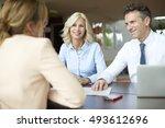 shot of an real estate agent... | Shutterstock . vector #493612696