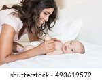 young mother with her baby in... | Shutterstock . vector #493619572