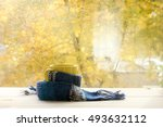 yellow mug in a warming scarf... | Shutterstock . vector #493632112