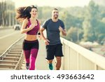 happy couple running over the... | Shutterstock . vector #493663642
