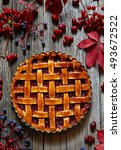 Small photo of Rustic Thanksgiving american raspberry pie preparation with jam and raspberries on wooden kitchen table background. Autumn creative composition decoration. Rustic style and natural light.