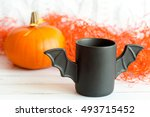 cup of coffee like a bat in ... | Shutterstock . vector #493715452