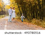 happy young family walking down ... | Shutterstock . vector #493780516