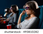 Small photo of All eyes on screen. Closeup portrait of a young female watching a movie wearing 3D glasses at the movie theatre