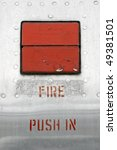 old fire emergency button embedded in a metal panel - stock photo