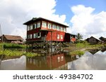 Water House with beautiful reflection at Inle Lake, Myanmar! - stock photo