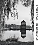 Small photo of black and white photo of Alum Lake 'Kamencove jezero' in Chomutov city with wooden pier at the end of the summer tourist season
