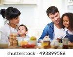 mixed race family   Shutterstock . vector #493899586