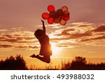 young women with balloons at... | Shutterstock . vector #493988032