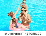 happy family in swimming pool... | Shutterstock . vector #494058172