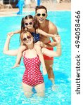 happy family in swimming pool... | Shutterstock . vector #494058466