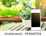 flower pot and white smartphone ... | Shutterstock . vector #494069926
