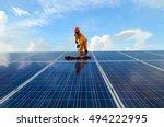 a  man  working  on solar... | Shutterstock . vector #494222995