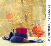 red mug in a woolen scarf is on ... | Shutterstock . vector #494232736
