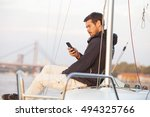 Handsome Man Using Cellphone O...