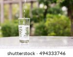 pouring water into a glass... | Shutterstock . vector #494333746