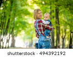 cheerful young mother with her... | Shutterstock . vector #494392192