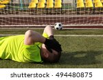 football player covers own face.... | Shutterstock . vector #494480875