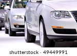 Many cars in line produced from the plant - stock photo