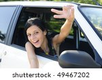 new car: teenage girl showing victory sign - stock photo
