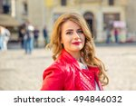 happy woman in a red jacket on... | Shutterstock . vector #494846032