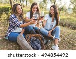 three happy women toasting with ... | Shutterstock . vector #494854492
