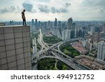 man stands on edge of roof of... | Shutterstock . vector #494912752