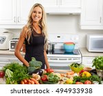 young woman cooking in the... | Shutterstock . vector #494933938