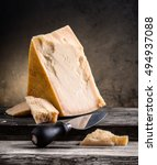 parmesan cheese on a wooden... | Shutterstock . vector #494937088