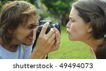 gorgeous couple take pictures... | Shutterstock . vector #49494073