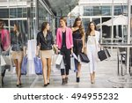 four girlfriends shopping... | Shutterstock . vector #494955232